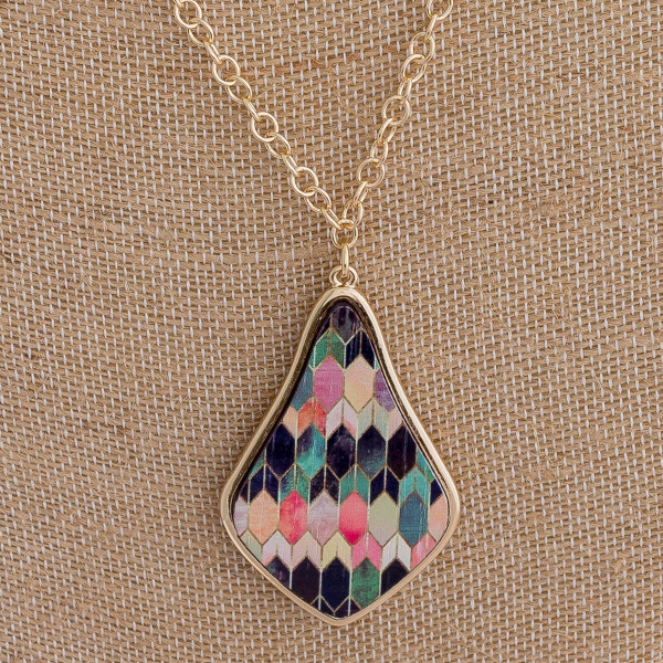 """Long gold chain necklace featuring beaded accents and a wooden pendant with a multicolored patterned design. Approximately 36"""" in length."""