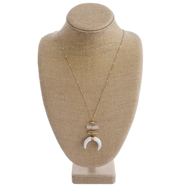 """Long gold metal necklace featuring a clear crescent pendant with a clear natural stone detail and gold accents. Approximately 38"""" in length."""