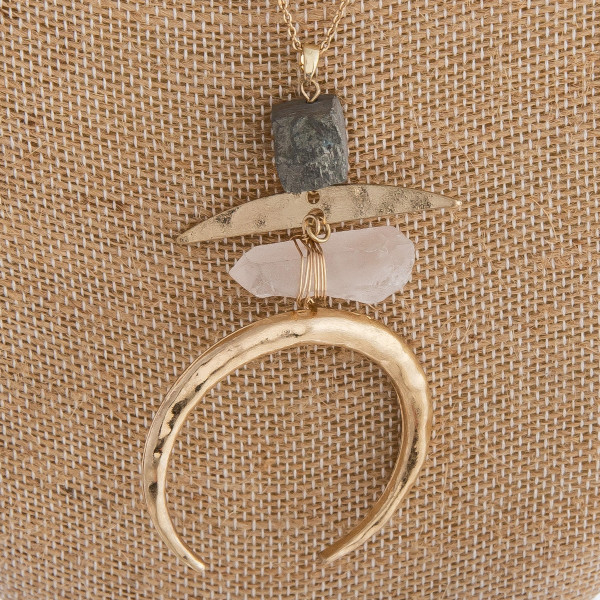 """Long metal necklace featuring a clear natural stone and a crescent detail. Approximately 36"""" in length."""