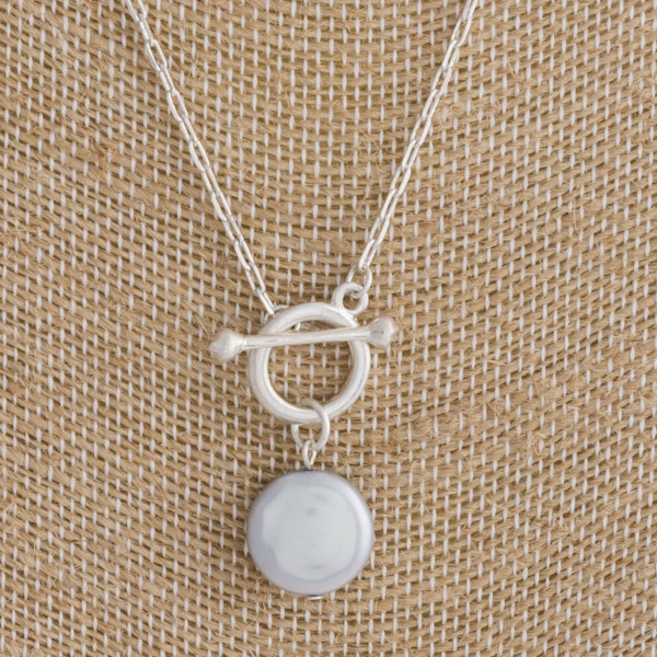 """Long cable link chain necklace featuring a pearl accent and toggle clasp closure. Approximately 18"""" in length."""
