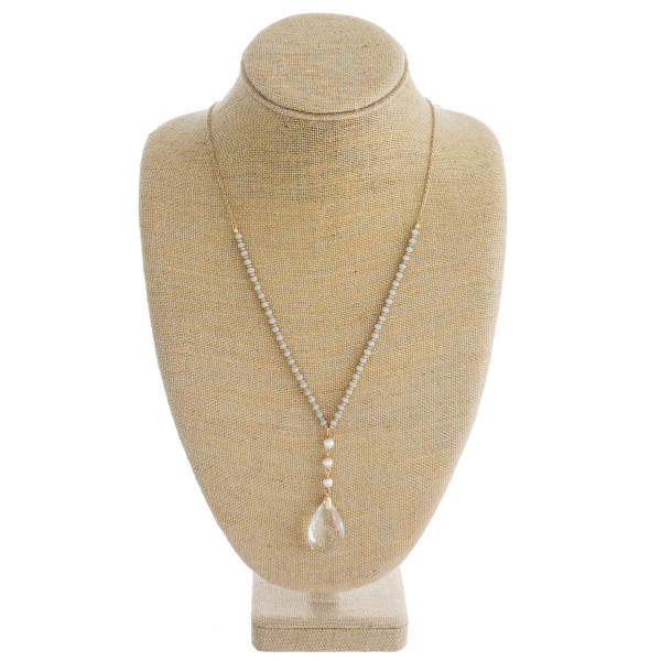 """Long cable chain necklace featuring faceted bead details, a crystal inspired teardrop pendant, and peal accents. Pendant approximately 1.5"""". Approximately 34"""" in length overall."""
