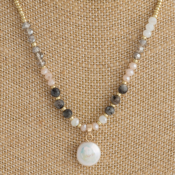 """Short beaded necklace featuring gold bead details, labradorite inspired accents, and a faux pearl. Approximately 16"""" in length."""