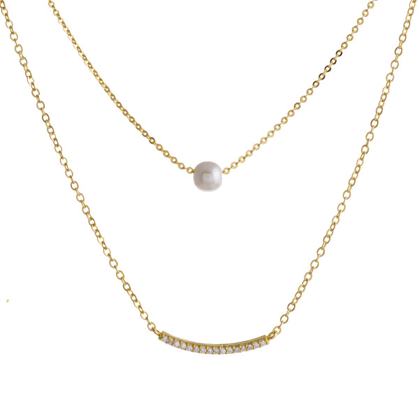 """Dainty layered chain necklace featuring a faux pearl accent and a curved cubic zirconia bar. Approximately 18"""" in length."""