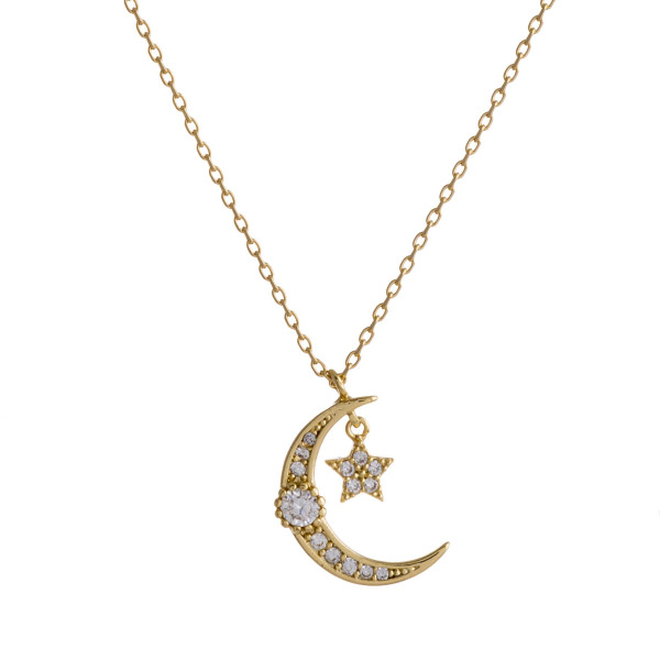 "Dainty gold chain necklace featuring a cubic zirconia adorned crescent pendant and a star accent. Approximately 18"" in length. Pendant is approximately 1"" in diameter."