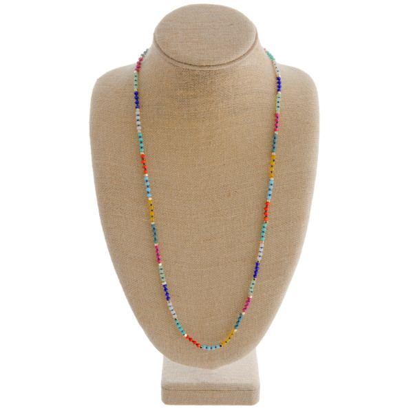 "Long multicolored beaded necklace featuring gold details. Measures approximately 36"" in length."