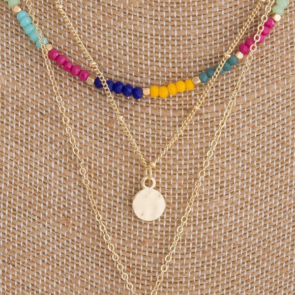 "Layered necklace featuring multicolored beaded details and gold accents. Measures approximately 20"" in length."