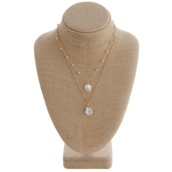 """Gold layered necklace featuring grey glass bead details and pearl accents. Measuring approximately 18"""" in length."""