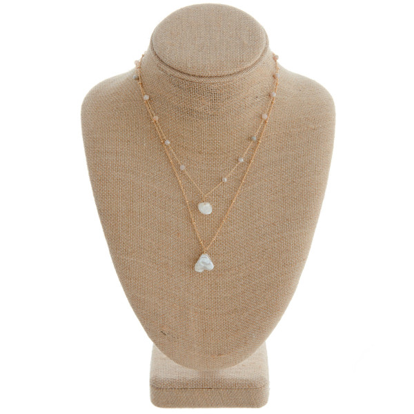 """Gold layered necklace featuring natural glass bead details and pearl accents. Measures approximately 18"""" in length."""