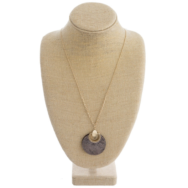 """Long cable chain necklace featuring a faux leather disc pendant with snakeskin details and gold metal accents. Pendant approximately 2"""" in diameter. Approximately 36"""" in length overall."""