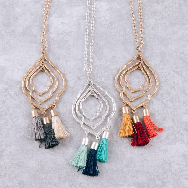 """Long chain necklace featuring a lotus inspired pendant with blue fanned tassel details. Pendant approximately 3"""". Approximately 34"""" in length."""