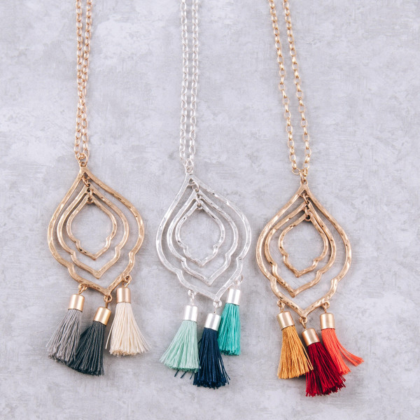 """Long chain necklace featuring a lotus inspired pendant with orange fanned tassel details. Pendant approximately 3"""". Approximately 34"""" in length."""