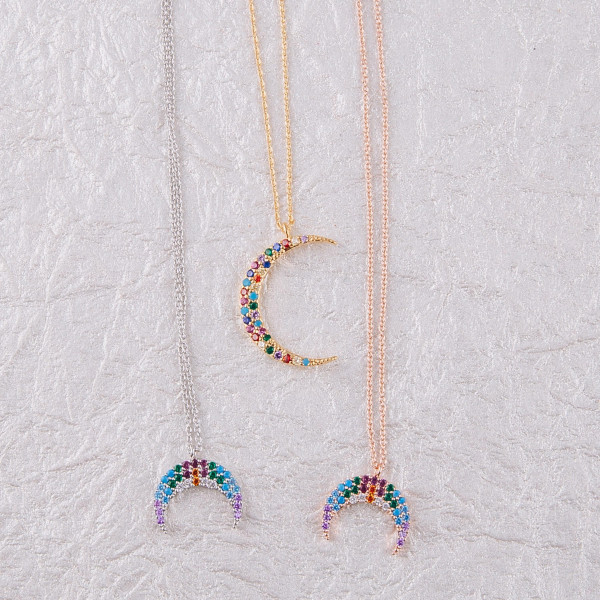 "Dainty cable chain necklace featuring a moon pendant with multicolor cubic zirconia details. Pendant approximately 1"". Approximately 18"" in length overall."