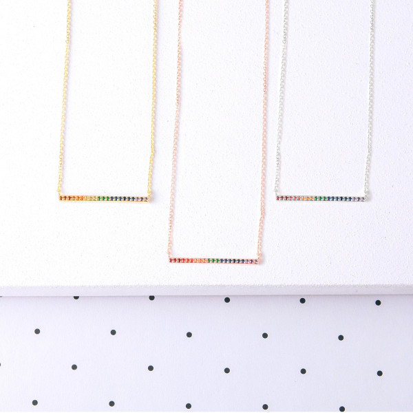 "Dainty cable chain necklace featuring a bar pendant with multicolor cubic zirconia details. Bar approximately 1.5"". Approximately 18"" in length."
