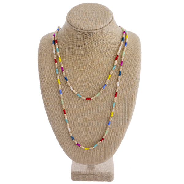 """Long two layered wood beaded necklace featuring multicolor faceted beads and gold accents. Shortest layer approximately 24"""". Approximately 32"""" in length overall."""