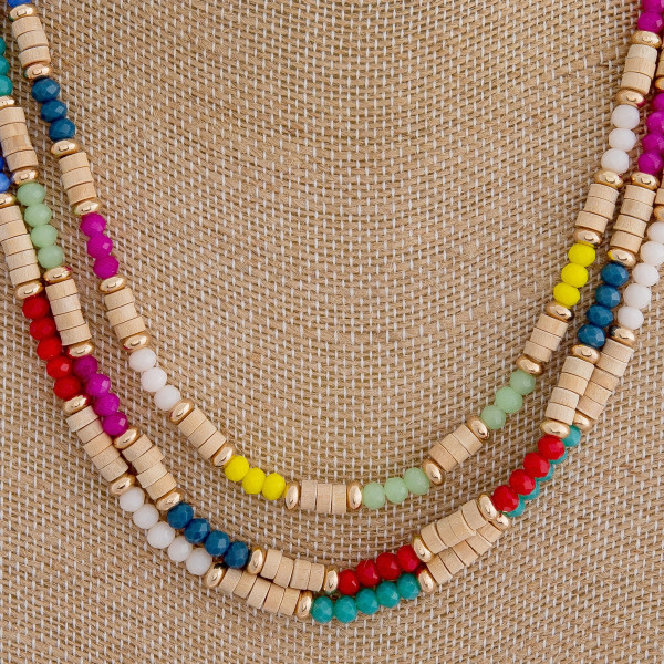 """Trio layered wood beaded necklace featuring multicolor faceted beads and gold accents. Approximately 16"""" in length."""