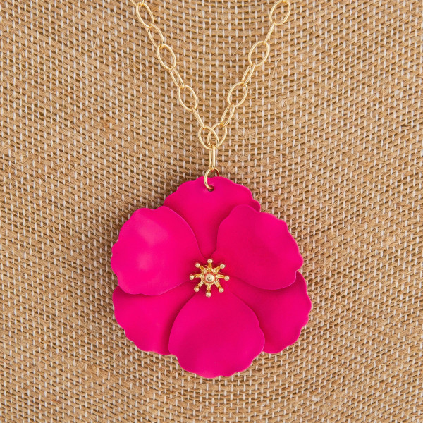 "Cable chain necklace featuring a metal flower pendant with a gold center detail. Pendant approximately 1.5"" in diameter. Approximately 20"" in length overall."