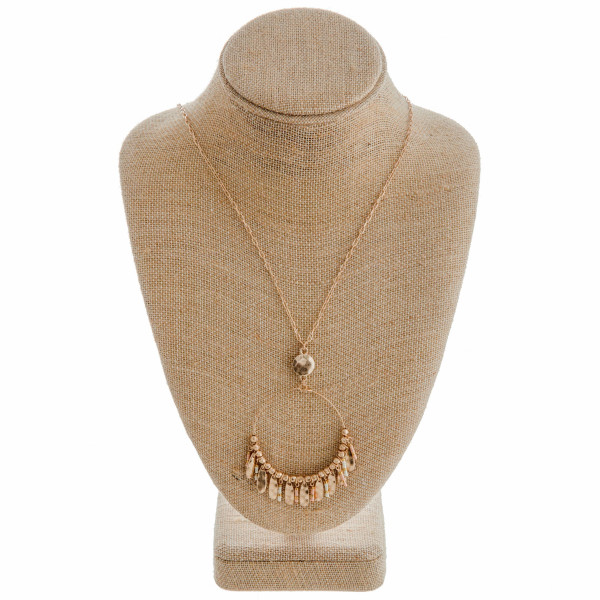 "Dainty oval link chain necklace featuring a circular pendant with beaded and metal tassel details. Pendant approximately 2.5"". Approximately 36"" in length overall."
