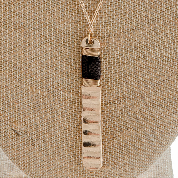 """Dainty cable chain necklace featuring a metal bar pendant with snakeskin details and wire wrapped accents. Pendant approximately 3"""". Approximately 36"""" in length."""