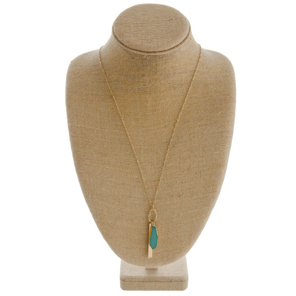 "Long cable chain necklace featuring a natural stone pendant with a metal bar accent. Pendant approximately 3.5"". Approximately 34"" in length overall."