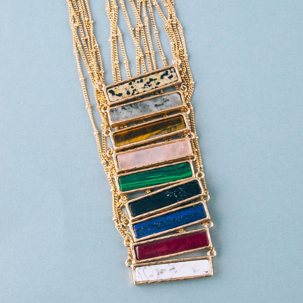 "Satellite chain necklace featuring a natural stone bar pendant. Bar approximately 1.5"". Approximately 16"" in length."