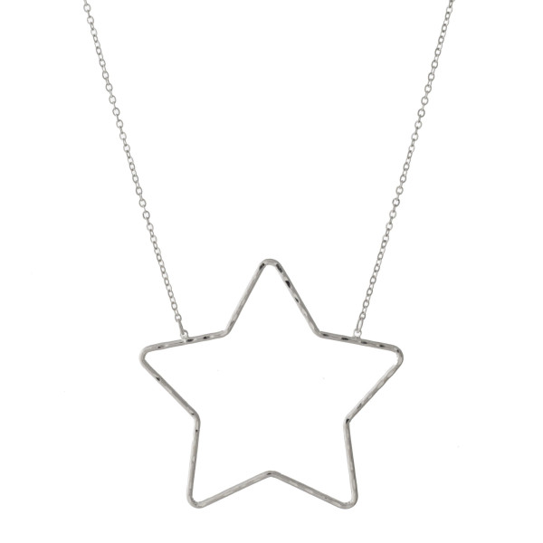 "Dainty cable chain necklace featuring a star pendant. Pendant approximately 2"". Approximately 20"" in length overall."