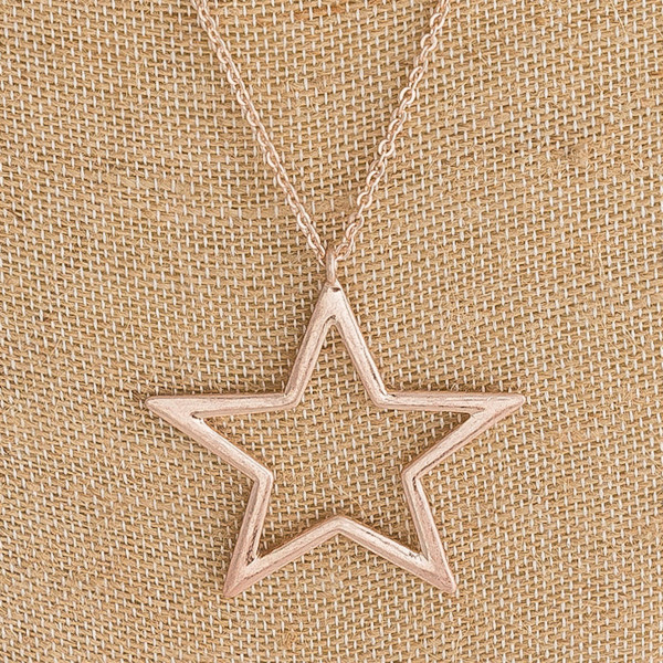 """Long cable chain necklace featuring a star pendant. Pendant approximately 2"""". Approximately 34"""" in length overall."""