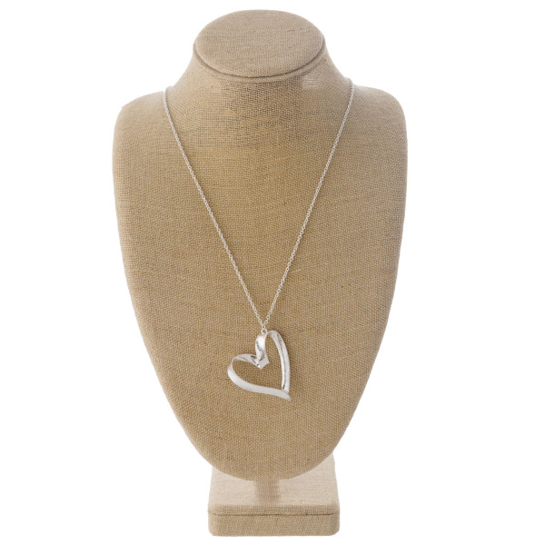 "Long cable chain necklace featuring a heart pendant. Pendant approximately 2"". Approximately 35"" in length overall."