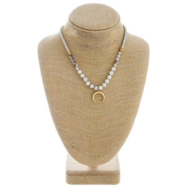"""Natural stone beaded necklace featuring a crescent detail and gold accents. Approximately 16"""" in length."""