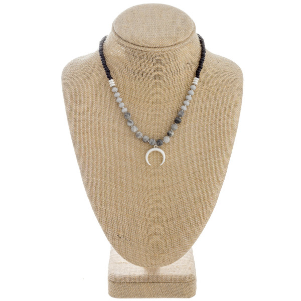 """Natural stone beaded necklace featuring a crescent detail and silver accents. Approximately 16"""" in length."""