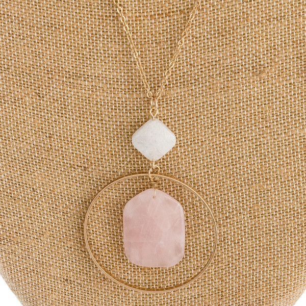 """Long cable chain necklace featuring a circular metal pendant with a natural stone inspired center detail and a resin accent. Pendant approximately 3"""". Approximately 36"""" in length overall."""
