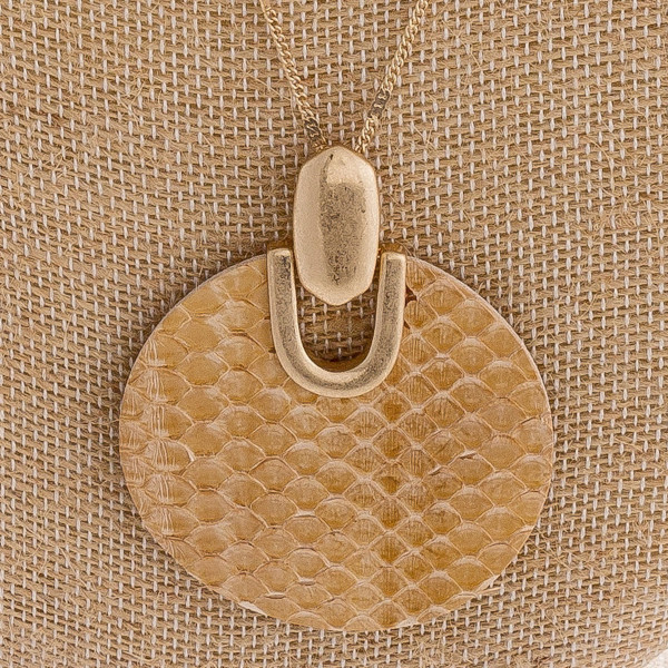 """Long dainty chain necklace featuring a genuine leather snakeskin disc pendant. Pendant approximately 2.5"""". Approximately 36"""" in length overall."""