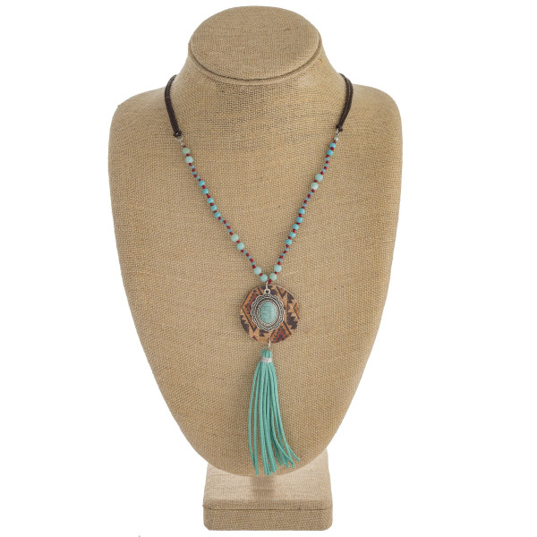 """Faux leather/beaded western style necklace featuring cork and tassel details. Approximately 34"""" in length."""