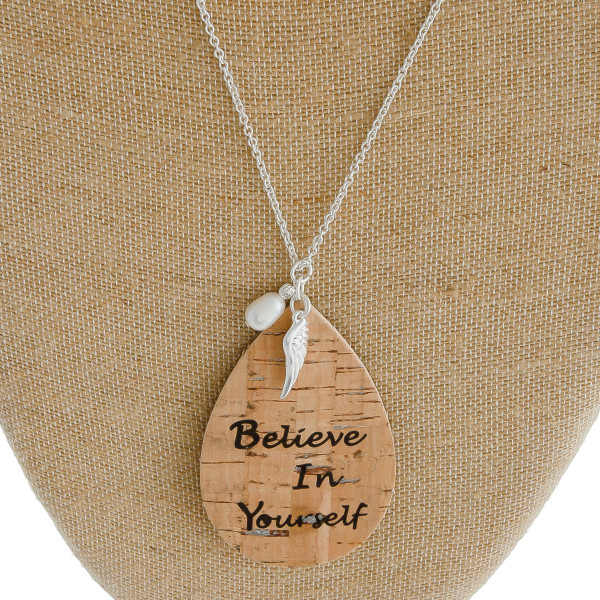 "Long cable chain necklace featuring a cork teardrop pendant with ""Believe In Yourself"" inspiring message with an angel wing and pearl accent . Pendant approximately 3.5"". Approximately 38"" in length overall."