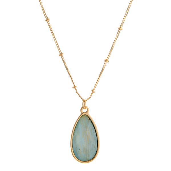 "Dainty satellite chain necklace featuring a iridescent acrylic teardrop pendant. Pendant approximately 1"". Approximately 18"" in length overall."