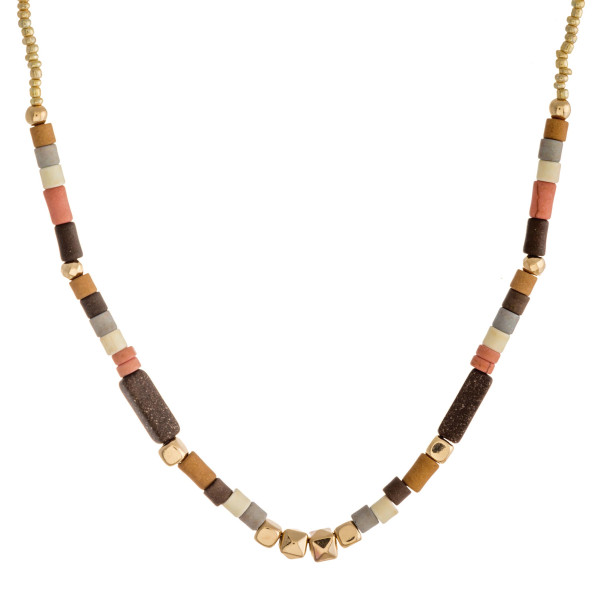 """Gold seed beaded necklace featuring color block bead details. Approximately 16"""" in length."""