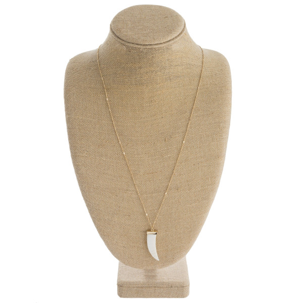 """Long dainty chain necklace featuring a mother of pearl inspired oblong pendant with a gold accent. Pendant approximately 2"""". Approximately 34"""" in length."""