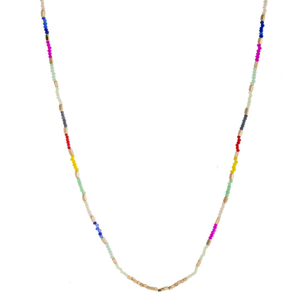 "Long dainty beaded necklace with faceted bead details and gold accents. Approximately 28"" in length."