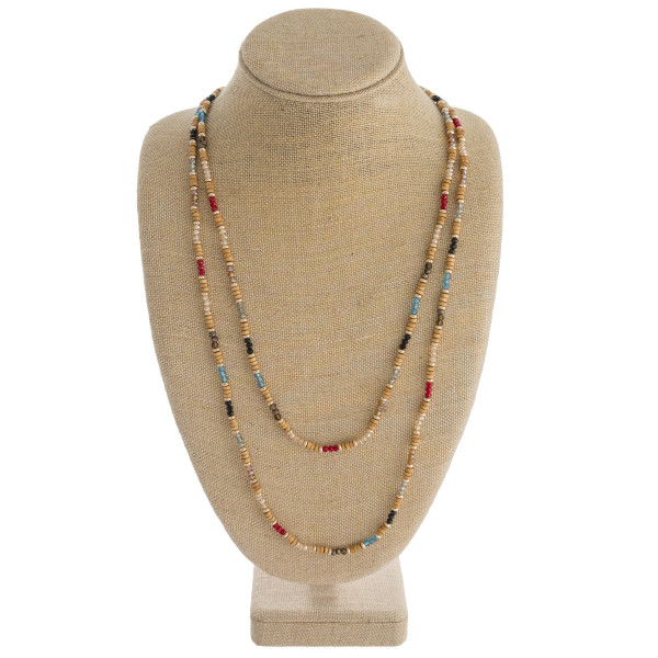 """Long double layered beaded necklace featuring wood, iridescent and faceted bead details. Approximately 32"""" in length."""