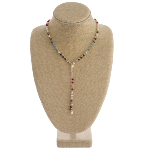 "Long y-thread chain necklace featuring acrylic and faceted bead details with pearl accents. Approximately 30"" in length."
