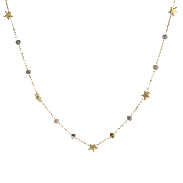 "Dainty beaded chain necklace with faceted bead details and star accents. Approximately 15"" in length."