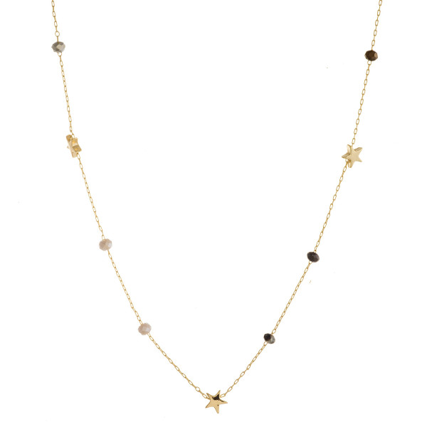 "Long dainty beaded chain necklace featuring faceted bead details with star accents. Approximately 32"" in length."