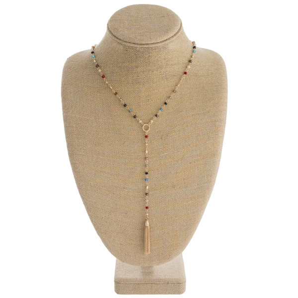 """Long y-beaded chain necklace featuring faceted bead details with chain-linked tassel accent. Approximately 44"""" in length."""