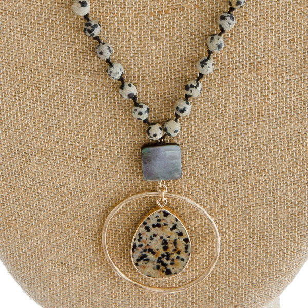 """Long oval link/faceted beaded necklace featuring a round pendant with natural stone an resin accents. Pendant approximately 2.5"""". Approximately 36"""" in length overall."""