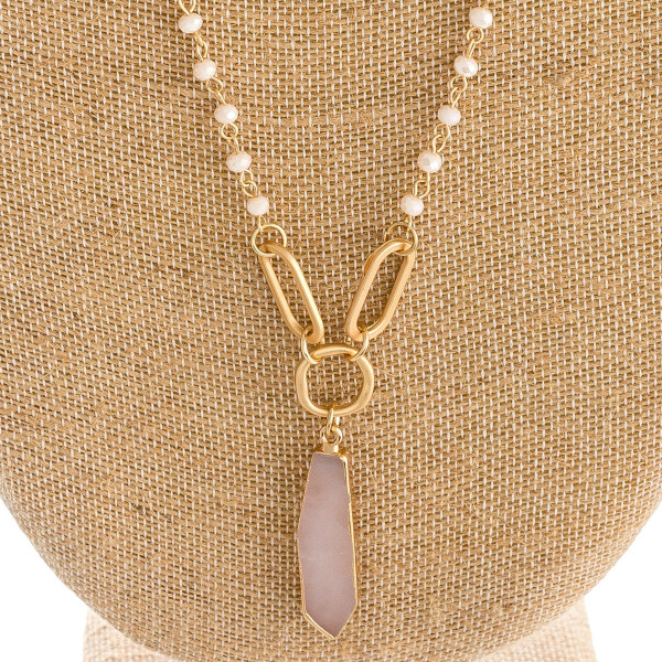 "Long iridescent beaded necklace featuring a natural stone inspired pendant and gold metal accents. Pendant approximately 2"". Approximately 34"" in length overall."
