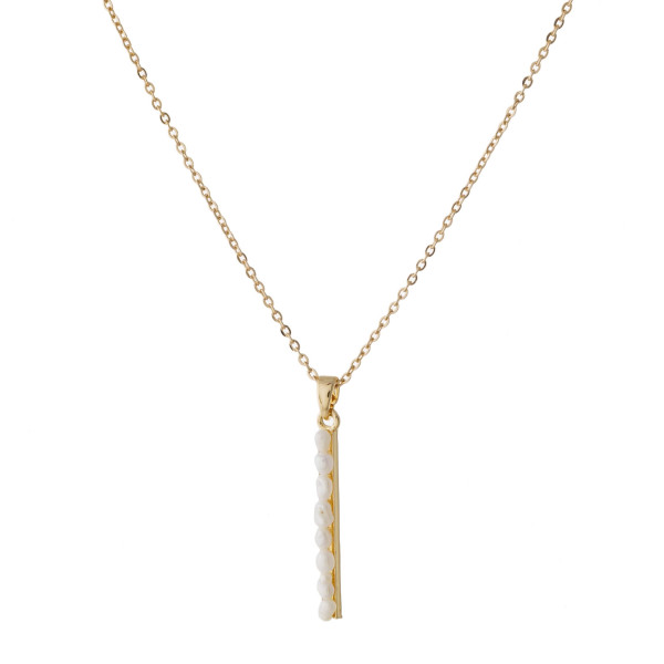 """Dainty cable chain necklace featuring a pearl beaded bar pendant. Pendant approximately 1"""". Approximately 16"""" in length overall."""