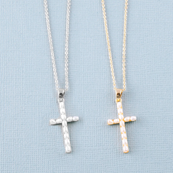 "Dainty cable chain necklace featuring a pearl beaded cross pendant. Pendant approximately 1"". Approximately 16"" in length overall."