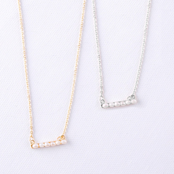 """Dainty cable chain necklace featuring a bar pendant with pearl beaded details. Pendant approximately .5"""". Approximately 16"""" in length overall."""