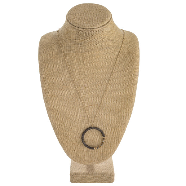 """Long satellite chain necklace featuring a faux leather snakeskin wrapped pendant with faceted bead details. Pendant approximately 2"""" in diameter. Approximately 34"""" in length overall."""
