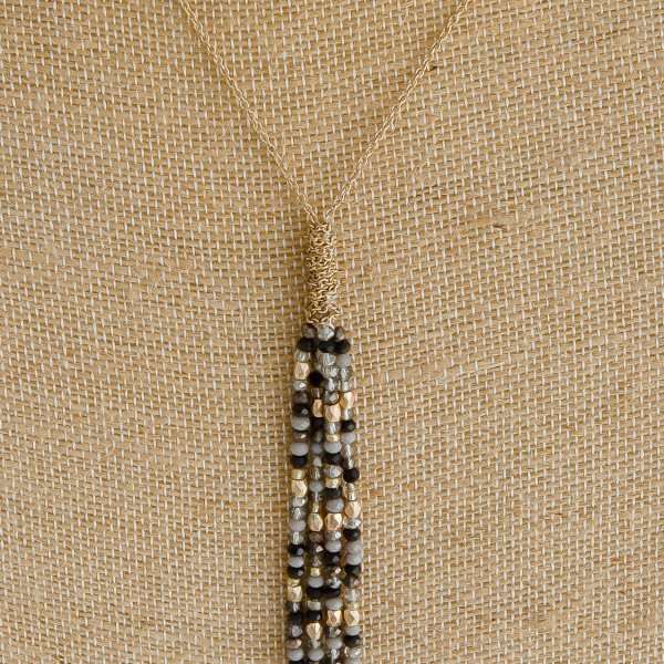 "Long dainty cable chain necklace featuring a iridescent beaded tassel pendant. Pendant approximately 8"". Approximately 42"" in length overall."