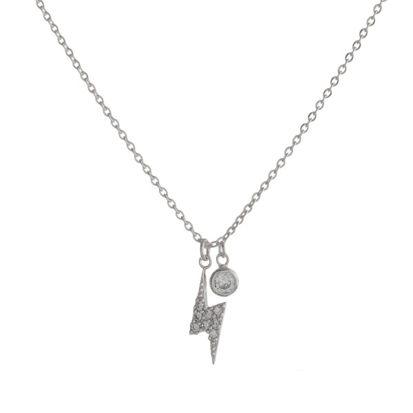 "Dainty cable chain necklace featuring a lightening bolt pendant with cubic zirconia details. Pendant approximately 1cm. Approximately 16"" in length overall."